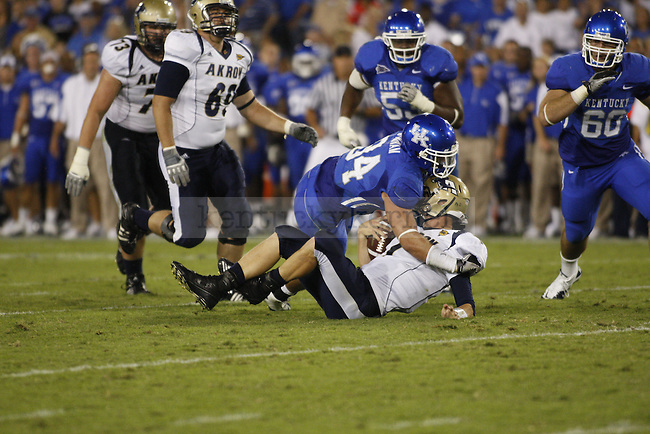 Defensive End Taylor Wyndham sacks Akron's quarterback during the second half of UK's home game against Akron, Saturday, September 17, 2010.  Photo by Brandon Goodwin | Staff