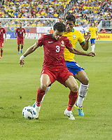 Portugal defender Pepe (3) fends Brazil midfielder Paulinho (18) off near the Portugal goal.  In an International friendly match Brazil defeated Portugal, 3-1, at Gillette Stadium on Sep 10, 2013.