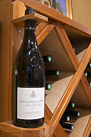 bottles on shelves chateauneuf les olivets 2006 wine shop domaine roger sabon chateauneuf du pape rhone france