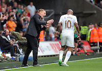 Pictured L-R: Swansea manager Garry Monk gives instruction to Andre Ayew after the goal scored by Bafetimbi Gomis Sunday 30 August 2015<br /> Re: Premier League, Swansea v Manchester United at the Liberty Stadium, Swansea, UK