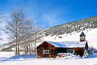 Snow Covered Log Church at Konni Lake, Nemaiah Valley, BC, British Columbia, Canada - Cariboo Chilcotin Coast Region, Winter