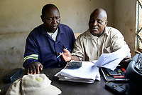 ZAMBIA, Mazabuka, Chikankata area, medium scale farmer Stephen Chinyama, contract cotton farmer for LDC Louis Dreyfuss Company, in talk with LDC distributor dealer Dominic Garapa, right