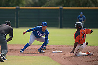 Kansas City Royals shortstop Jeison Guzman (1) prepares to catch a ball on a stolen base attempt by Jalen Miller (10) during an Instructional League game against the San Francisco Giants at the Giants Training Complex on October 17, 2017 in Scottsdale, Arizona. (Zachary Lucy/Four Seam Images)