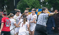 Newton, Massachusetts - May 19, 2018: NCAA Division I tournament, third round. In overtime, Boston College (white) defeated Stony Brook University (red/blue), 12-11, at Newton Campus Lacrosse Field.<br /> Overtime goal. Goal celebration.