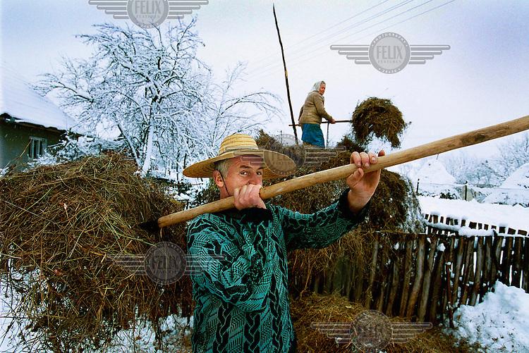 Elderly couple farming their land.