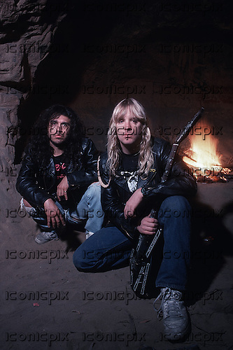 Slayer - vocalist Tom Araya and guitarist Jeff Hanneman (Jan 31, 1964 - May 02, 2013)  - Photographed here at the caves in Sherman Oaks California USA - 1988.  Photo credit: Alex Solca/IconicPix