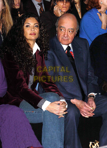 AFEF AL FAYED & MOHAMED AL FAYED.Robert Cavalli's Women's fashion show Collections Autumn/Winter 2005/2006,Milan Fashion Week, Milan, Italy,.25th February 2005..half length sitting.Ref: OME.www.capitalpictures.com.sales@capitalpictures.com.©Omega/Capital Pictures .