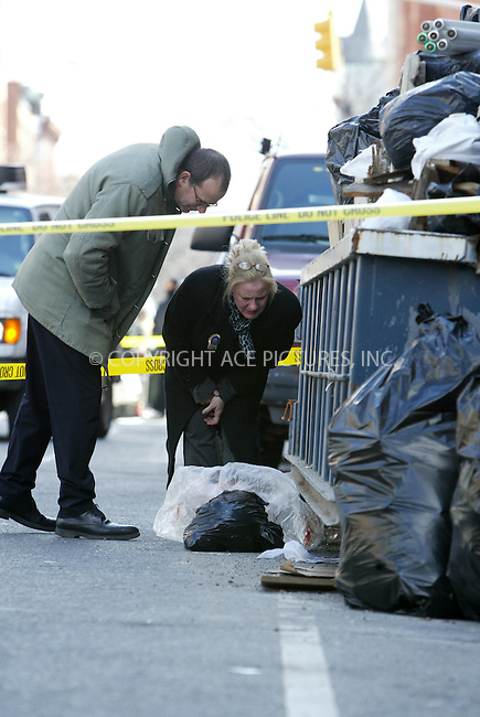WWW.ACEPIXS.COM . . . . .  ....February 28 2006, New York City....A headless body was descovered on E119th street in Harlem wrapped in a black plastic bag on the sidewalk amidst a pile of garbage. The head was descovered lying on the road next to an overflowing dumpster, also wrapped in a black plastic bag. Police and relevant agencies sealed the crime scene and proceded to examine and photograph the body parts.........Please byline: JENNIFER L GONZELES-ACEPIXS.COM.... *** ***..Ace Pictures, Inc:  ..Philip Vaughan (212) 243-8787 or (646) 769 0430..e-mail: info@acepixs.com..web: http://www.acepixs.com
