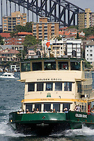 The Cremorne Ferry, on its way over from Circular Quay, with part of Sydney Harbour Bridge in the background. In Sydney, Australia, the harbour ferries remain a popular way of getting round the huge harbour and many people travel to work that way.
