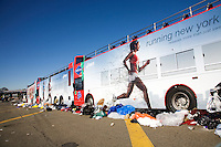 Discarded clothing and other trash litters the starting area onto the Verrazano-Narrows Bridge after the start of the ING New York City Marathon on Staten Island on 07 November 2010.