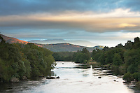 River Spey looking upstream from the road bridge towards the Cairngorm Mountains, Boat of Garten, Scotland, Uk