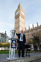 PICTURE BY ALEX BROADWAY/SWPIX.COM - Rugby League - RLWC2013 - Rugby League World Cup Parliament Visit - Westminster, London, England  - 31/10/12 - MP's have their photograph taken with the Rugby League World Cup outside the Houses of Parliament. David Blunkett.