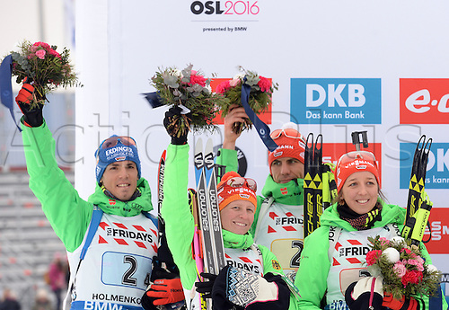 03.03.2016. Holmenkollen, Oslo, Norway.  Silver medalists (L-R) Simon Schempp, Franziska Hildebrand, Arnd Peiffer and Franziska Preuss of Germany celebrate during the flower ceremony for the mixed relay competition at the Biathlon World Championships, in the Holmenkollen Ski Arena, Oslo, Norway, 03 March 2016.