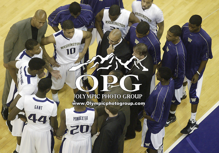27 December 2009:  Washington Huskies head coach Lorenzo Romar instructs his players during a timeout against San Francisco. Washington won 86-71 over San Francisco at the Bank of America Arena in Seattle, WA.