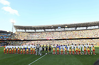 Ghana and Serbia line up before the game for the national anthems.