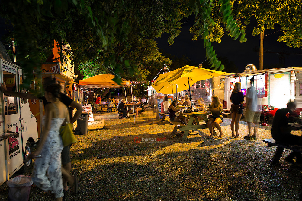 Austin's East 6th Street is home to a hip food trailer court surrounded by shops, bars, and live music venues the food trailer is busy late nights feeding hungry nightlife patrons.