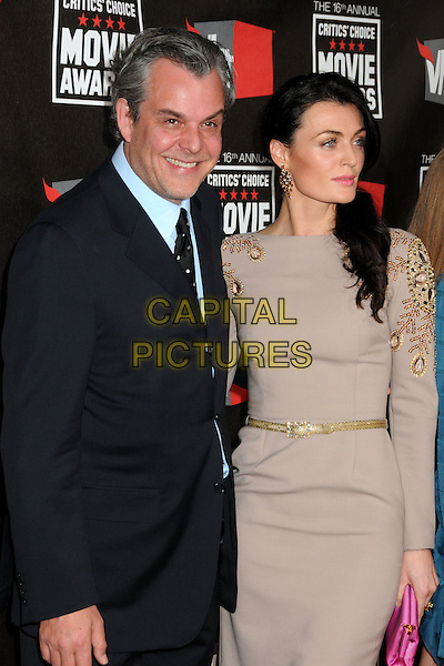 DANNY HUSTON & GUEST .at The16th Annual Critics' Choice Movie Awards held at The Hollywood Palladium in Hollywood, California, USA, January 14th, 2011..half length blue shirt tie suit beige dress gold belt .CAP/ADM/BP.©Byron Purvis/AdMedia/Capital Pictures.