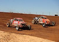 Apr 16, 2011; Surprise, AZ USA; LOORRS driver Pat Dean (21) and Joe Masek (13) during round 3 at Speedworld Off Road Park. Mandatory Credit: Mark J. Rebilas-.
