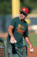 Boise Hawks hitting coach Bill Buckner #22 throws batting practice before a game against the Eugene Emeralds at PK Park on July 25, 2013 in Eugene, Oregon. Eugene defeated Boise, 5-4. (Larry Goren/Four Seam Images)