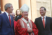 Washington, D.C. - October 2, 2005 - United States President George W. Bush attends 52nd Annual Red Mass at St. Matthews Cathedral.  Red Mass is a tradition that is held the Sunday prior to the Supreme Court's opening session.  The service gives special prayers for the court and the judges as they start hearing this session's cases.   This mass is special in that the new Chief Justice, John G. Roberts, Jr. was in attendance along with his wife Jane.  First lady Laura Bush was in attendance as well as United States Secretary of State Condoleezza Rice and White House Chief of Staff Andrew Card.  Cardinal Theodore McCarrick, Archbishop of Washington, presides over mass and then walked out of the church at the end of the ceremony and stood on the steps next to President Bush and Chief Justice John Roberts.  Left to right: President Bush, Cardinal McCarrick, Chief Justice Roberts..Credit: Gary Fabiano - Pool via CNP