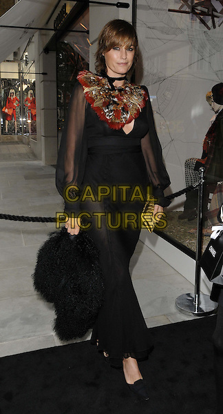Yasmin Le Bon<br /> The Chanel new flagship boutique launch party, Chanel, New Bond St., London, England.<br /> June 10th, 2013<br /> full length black sheer dress red cold collar bib<br /> CAP/CAN<br /> &copy;Can Nguyen/Capital Pictures