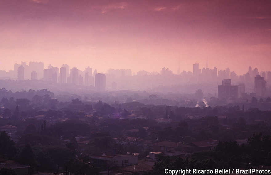 Sao Paulo cityscape showing air pollution and skyline of the city during sunset, Brazil.