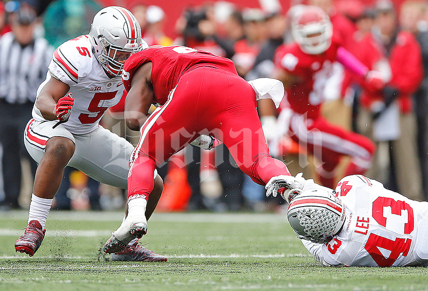 Ohio State Buckeyes linebacker Raekwon McMillan (5) and Ohio State Buckeyes linebacker Darron Lee (43) combine to stop Indiana Hoosiers running back Jordan Howard (8) in first half play at Memorial Stadium on October 3, 2015. (Chris Russell/Dispatch Photo)