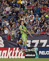 New England Revolution midfielder Chris Tierney (8) and Seattle Sounders FC midfielder Alvaro Fernandez (15) battle for head ball.  The New England Revolution defeated the Seattle Sounders FC, 3-1, at Gillette Stadium on September 4, 2010.