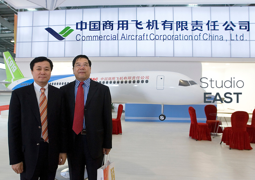 He Dongfeng, vice-president of Comac (Commercial Aircraft Corporation of China Ltd., left), and Yang Chunsheng, Executive vice-president of Avic (right), pose with a model of future C919 plane, during an Aviation summit in Lingang industrial park, in the outskirts of Shanghai, China, on April 15, 2010. Photo Lucas Schifres/Pictobank