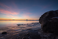 Cook Inlet, the Aleutian Range and Kenai Beach experience one of the plentiful, vibrant sunsets that Alaska's wintertime brings.