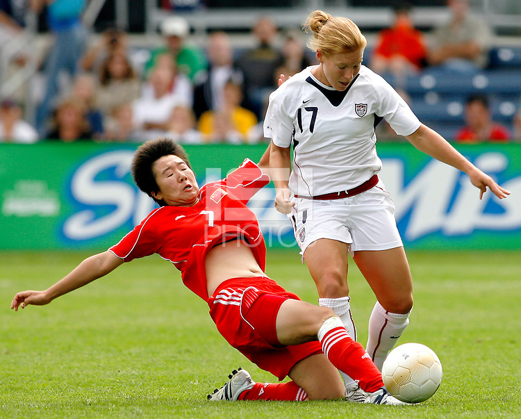 China defender Bi Yan (7) slide tackles the ball away from USA defender Lori Chalupny (17).  The U.S. Women's National Team defeated China 4-1 at Toyota Park in Bridgeview, IL on August 28, 2006.