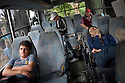 ISTANBUL, TURKEY-- JUNE 2, 2013-- People sleep inside a destroyed police bus parked at the edge of Gezi Park on Sunday, following several days of civic unrest. PHOTO BY JODI HILTON