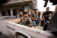 Photographer: Rick Findler..06.10.12 Members of the Free Syrian Army get a lift to the front lines of the battle between FSA and soldiers loyal to President Assad in the city of Aleppo, Syria.