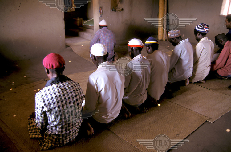 Men praying in mosque.