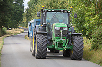 John Deere tractor and trailer on the public road<br /> &copy;Tim Scrivener Photographer 07850 303986<br />      ....Covering Agriculture In The UK....