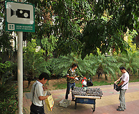 """CCTV cameras are positioned all around the city od Sh, Shenzhen, China.   The city is the test ground for a """"Golden shield"""" surveilance system that plan to use face recognition data along with other biometric data to keep a tab on the country's citizens."""