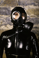 File Photo Montreal (Quebec) CANADA<br /> Sado masochist latex costume with gaz mask<br /> Photo (c) P Roussel / Images Distribution