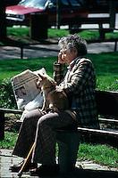 An old woman reading Montreal english newspaper THE GAZETTE, circa 1988