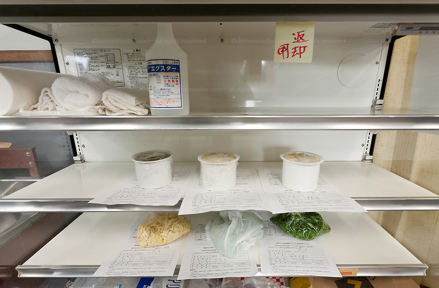 Food samples are stored in a refrigerator until results are known at the Becquerel Centre in a farmers' market in Miharu, where locally grown food is tested for nuclear contamination. Miharu, Fukushima, Japan. Friday May 4th 2012