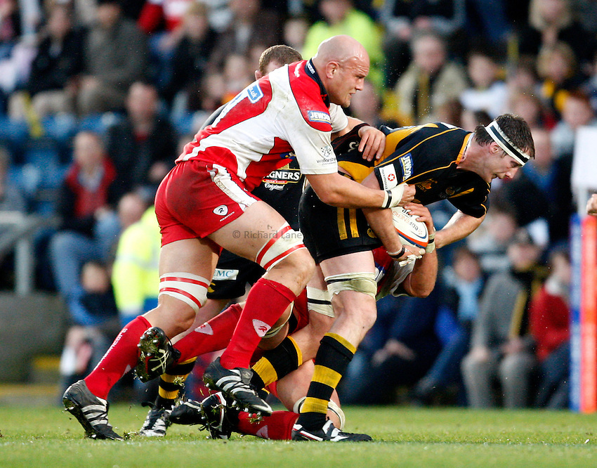 Photo: Richard Lane/Richard Lane Photography..London Wasps v Gloucester Rugby. EDF Energy Cup. 04/11/2007. .Wasps' Richard Birkett attacks as Glouceter's Will James tackles.