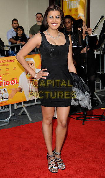 POOJA SHAH.The World Premiere of 'The Infidel' at the Hammersmith Apollo, London, England, UK..April 8th, 2010.arrivals full strappy sandals length black dress hands on hips sleeveless sequined sequin .CAP/CAN.©Can Nguyen/Capital Pictures.