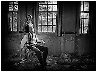 Portrait of a man and a woman at West Park abandoned asylum.