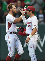 NWA Democrat-Gazette/ANDY SHUPE<br />Arkansas left fielder Luke Bonfield (17) is congratulated at the plate by third baseman Carson Shaddy Friday, March 17, 2017, after hitting a 2-run home run scoring Chad Spanberger during the first inning against Mississippi State at Baum Stadium in Fayetteville. Visit nwadg.com/photos to see more photographs from the game.