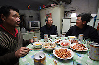 We share the meal of farmers in a two-room mud house in Yongfu, on February 27, 2006. Photo by Lucas Schifres/Pictobank