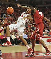 NWA Democrat-Gazette/Michael Woods --01/06/2015--w@NWAMICHAELW... University of Arkansas guard Michael Qualls is fouled by Alabama defender Jimmie Taylor as he drives to the hoop in the 2nd half of the Razorbacks 93-91 overtime victory against Alabama during Thursday nights game at Bud Walton Arena in Fayetteville.