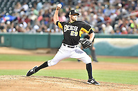 Ryan Chaffee (29) of the Salt Lake Bees delivers a pitch to the plate against the Fresno Grizzlies at Smith's Ballpark on May 25, 2014 in Salt Lake City, Utah.  (Stephen Smith/Four Seam Images)