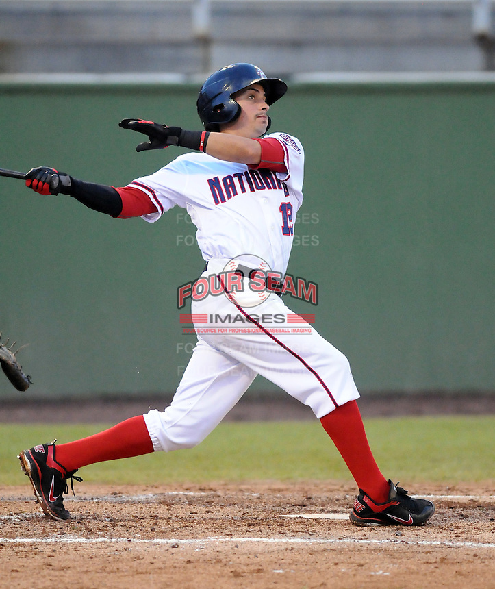 Infielder Jose Lozada (12) of the Potomac Nationals, Carolina League affiliate of the Washington Nationals, in a game against the Salem Red Sox on June 16, 2011, at Pfitzner Stadium in Woodbridge, Va. Photo by Tom Priddy / Four Seam Images