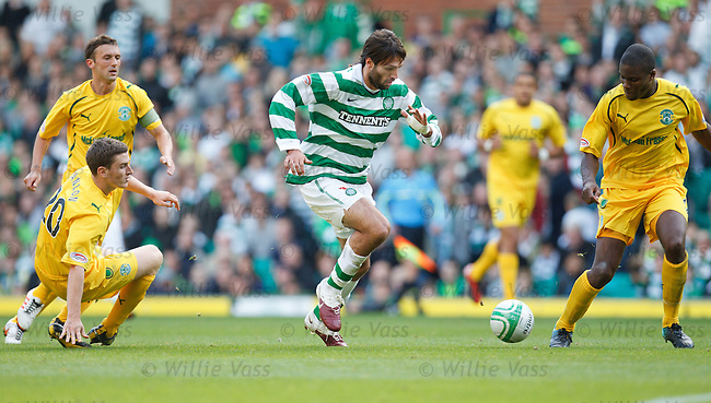 Georgios Samaras twists and turns his way through the Hibs defence