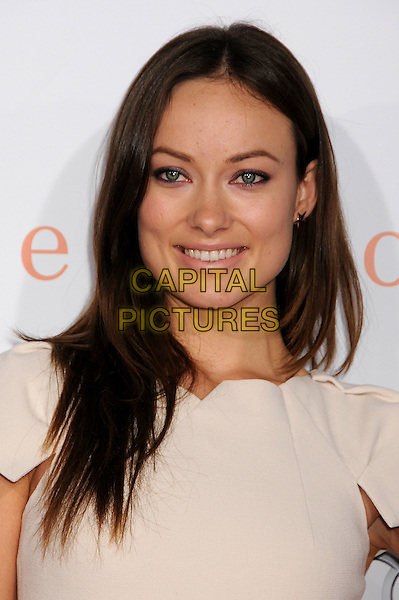 "OLIVIA WILDE .2009 AFI Film Festival Premiere of ""Precious"" held at Grauman's Chinese Theatre, Hollywood, California, USA,.1st November 2009..portrait headshot cream smiling beige  .CAP/ADM/BP.©Byron Purvis/Admedia/Capital Pictures"