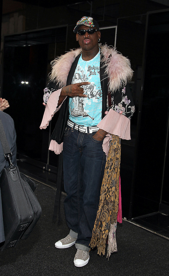 Coach Dennis Rodman is seen departing the press conference for HQ's strippers basketball team in New York, on Thursday, Mar. 01, 2012. (AP Photo/ Donald Traill)